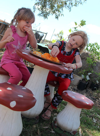 Calista and Brioni sit on toadstools, October 2013