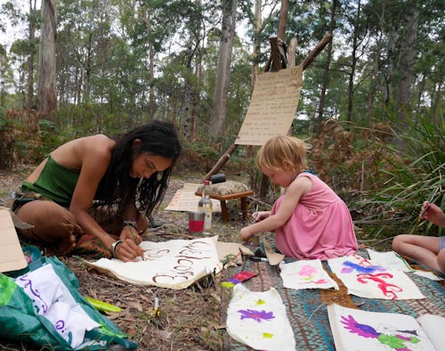 Laxmi and Lana painting signs, Tasmanian Rainbow Gathering, January 2014