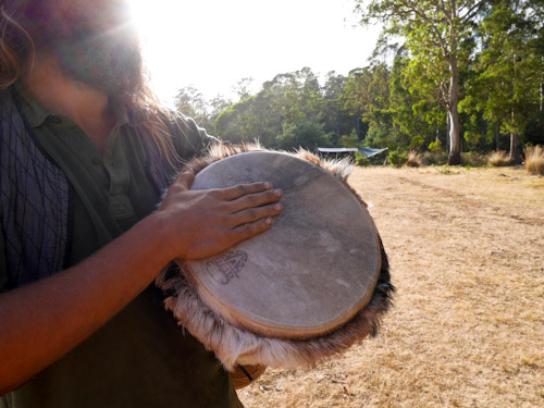 Olly plays a drum on the first day of the Tasmanian Rainbow Gathering, January 2014