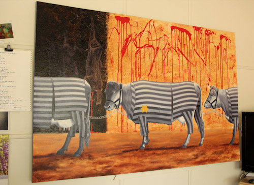Painting of cows going to the slaughter dressed as Jewish holocaust victims at a concentration camp, Jo Frederiks, vegan artist, animal activist, using art to raise awareness of animal suffering and inspiring change to a cruelty-free lifestyle, August 201