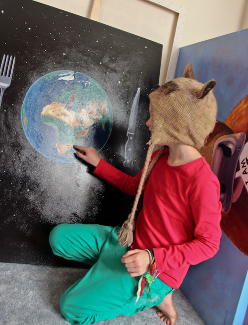 Painting of a cracked and bleeding Planet Earth with a huge knife and fork, Jo Frederiks, vegan artist, animal activist, using art to raise awareness of animal suffering and inspiring change to a cruelty-free lifestyle, August 2014