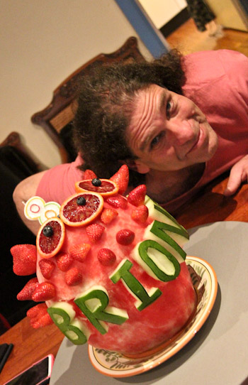 Hagai Erman and the vegan birthday cake — a carved watermelon — for Brioni's 8th birthday, August 2014