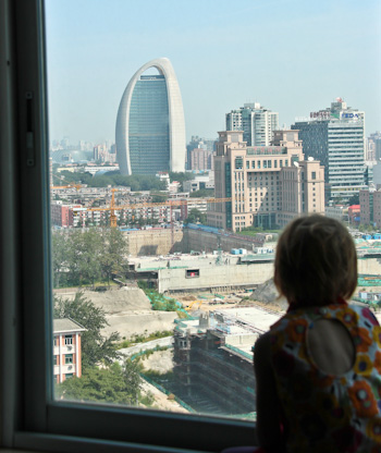 Lana looking out the window at the Beijing skyline, August 2014