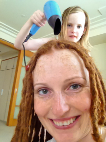 Aisha hair-drying Lauren's dreadlocks, August 2014