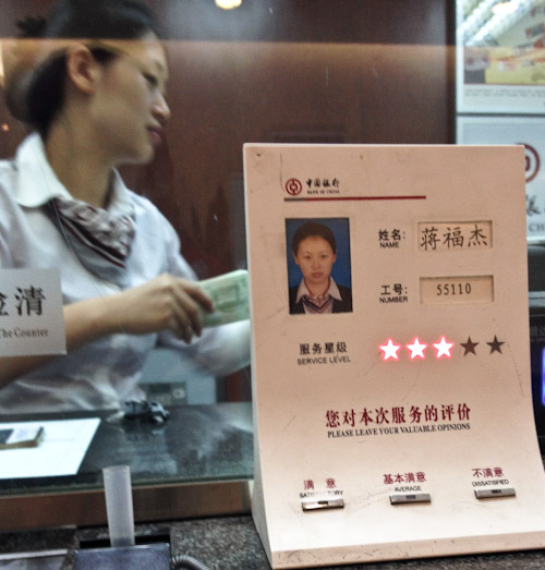 Service rater at desk of clerk, Beijing, China, August 2014