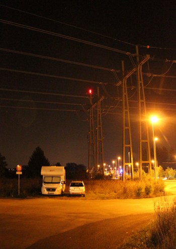 Campervan parked under power lines outside CERN, Geneva, Switzerland, September 2014