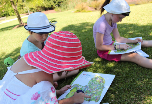 Girls looking at maps, Hunter Valley Gardens, NSW, January 2015