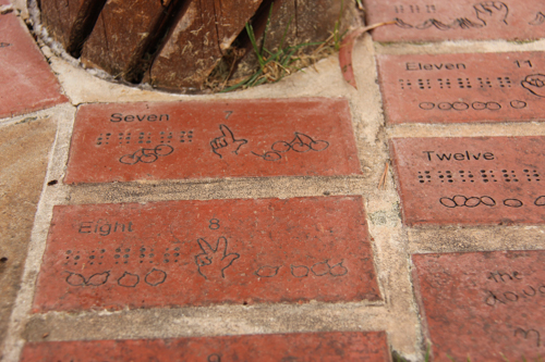 Sign-language and braille on pavers, Bathurst's Adventure Playground, NSW, January 2015