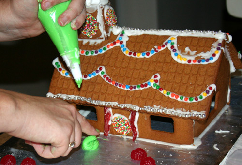 Decorating gingerbread houses, December 2009