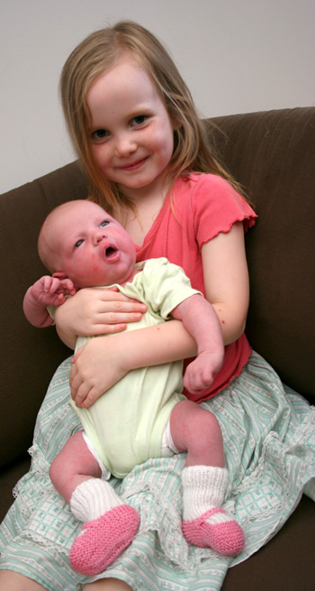 Delaney, 1 week old, + Aisha, 4yo, January 2010