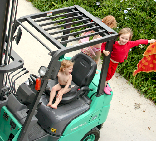 Playing on the forklift, July 2010