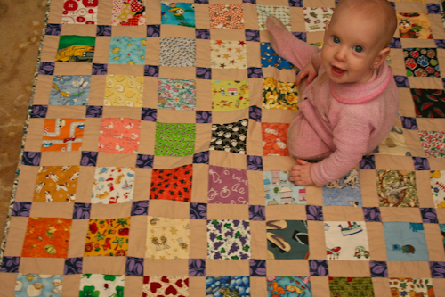 I spy quilt + Delaney, 8 months old, September 2010