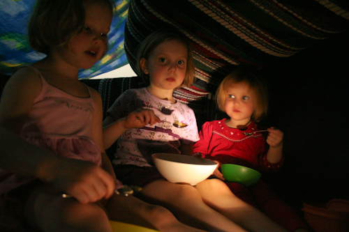 The girls playing in a couch-cubby-house, September 2010