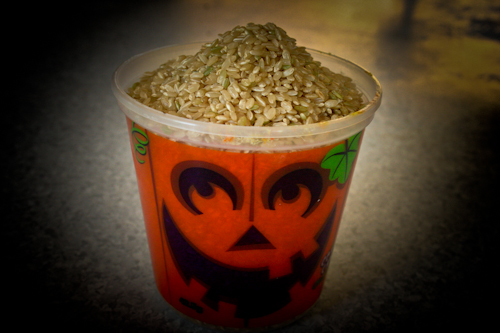 Halloween cup filled with brown rice