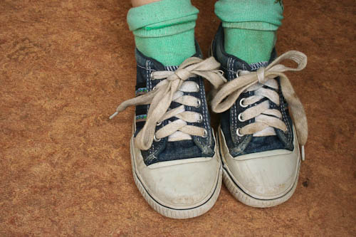 Just like when normally tying your shoes, you cross the laces and pull one side through to start the initial knot