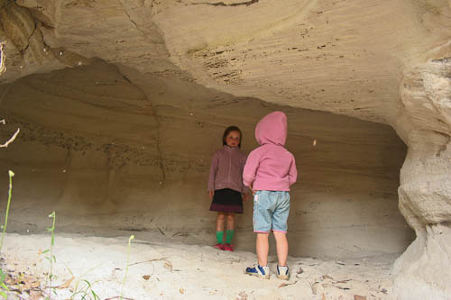 Exploring a cave at Mount Moffat, November 2010