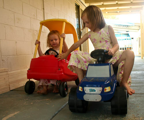 Brioni and Aisha playing on cars, January 2011