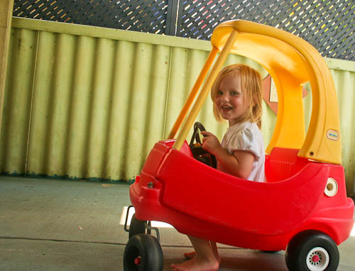 Calista in a toy car, January 2011