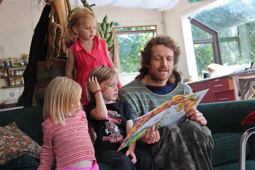 Aisha, Brioni and Calista listening to Johnny read a story, March 2011