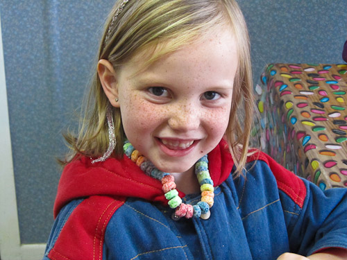 Making sweet necklaces with fruit loops, June 2011