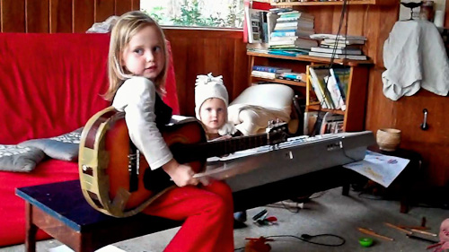Calista and Aisha on musical instruments, June 2011