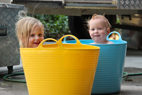 Calista and Delaney bathing in tubs, August 2011