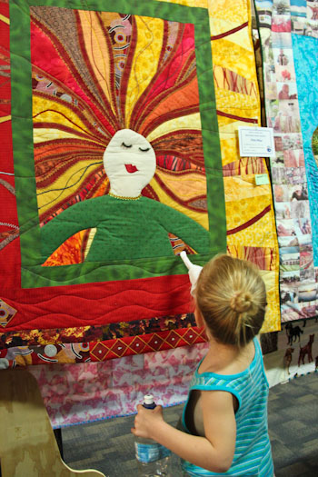 Calista touching a quilt at the Beenleigh Show, September 2011