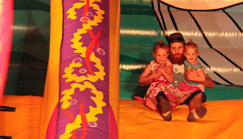 David with Brioni and Calista on a jumping castle slide, September 2011