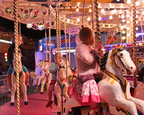Riding the merry-go-round at the Beenleigh Show, September 2011