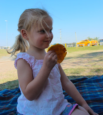 Calista eating a mango, September 2011