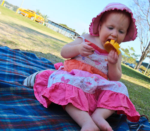 Delaney eating a mango, September 2011