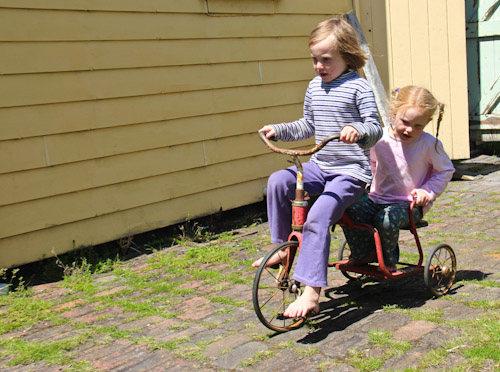 Aisha and Brioni on an old tricycle, October 2011
