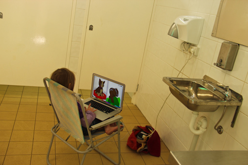 Aisha playing on the computer in the bathroom at Oberon, October 2011
