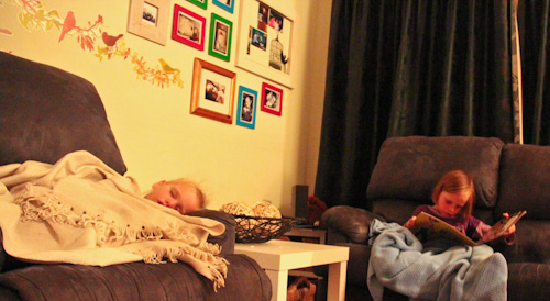 Calista sleeping and Aisha reading, October 2011