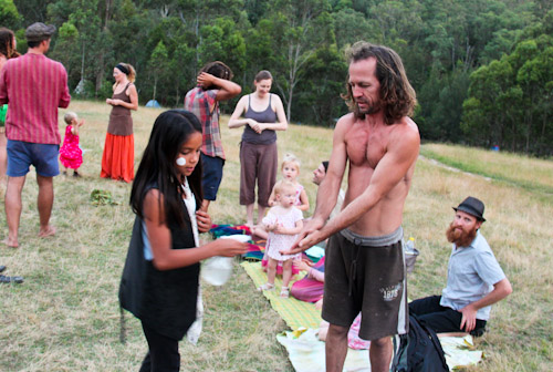 Spraying our hands with teatree, Rainbow Gathering, November 2011