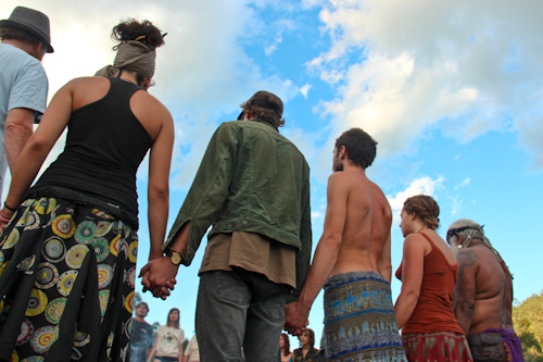 Holding hands in a circle, Rainbow Gathering, November 2011