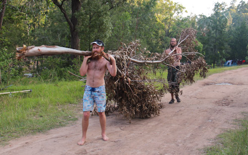 David helping Sacha carry firewood, Rainbow Gathering, November 2011