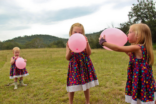 Girls blowing balloons, December 2011