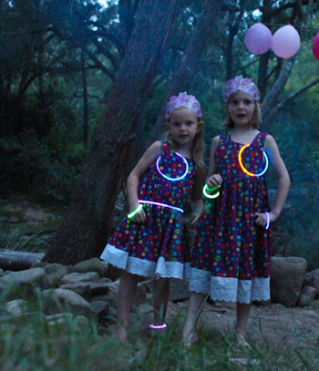 Brioni and Aisha pose with their glow-sticks, December 2011