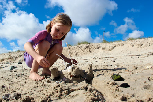 Aisha with a sandcastle, January 2012