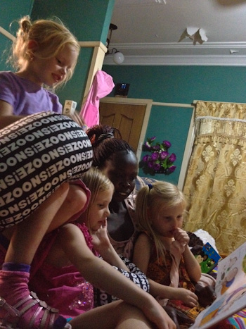 Hakima reading books to our girls, February 2012