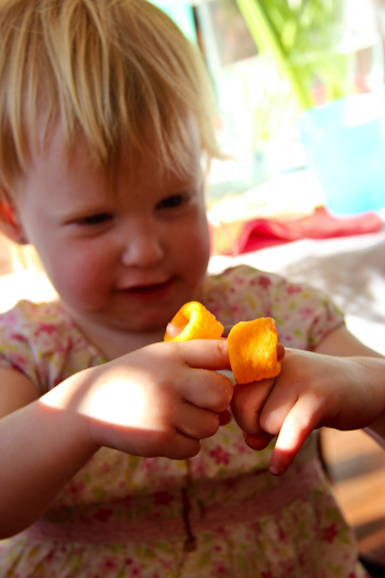 Delaney with cheezels on her fingers, August 2012