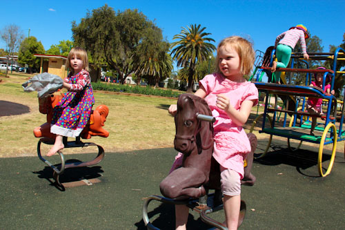 Calista and Brioni on the playground equipment, Memorial Park, Kingaroy, September 2012
