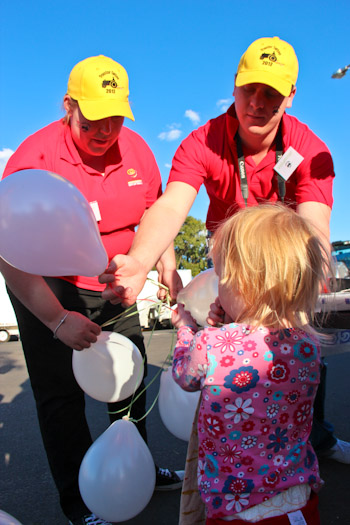 Volunteers hand out balloons at the Tractor Tattoo festival, Kingaroy, September 2012