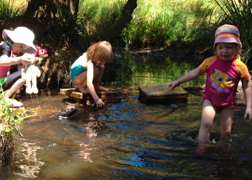 Aisha, Calista and Delaney playing in the creek at Hosanna Farmstay, October 2012