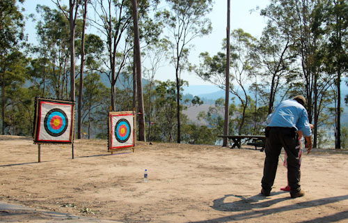 Brioni learns archery, homeschoolers camp, Camp Lake Fire, October 2012