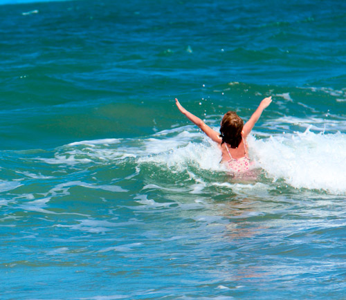 Brioni in the waves, Campwin Beach, Sarina, November 2012