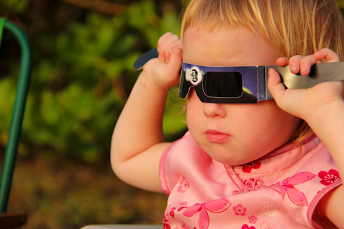 Delaney using eclipse glasses, November 2012
