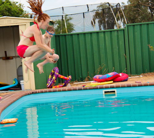 Lauren jumping into the pool with Bowen, November 2012