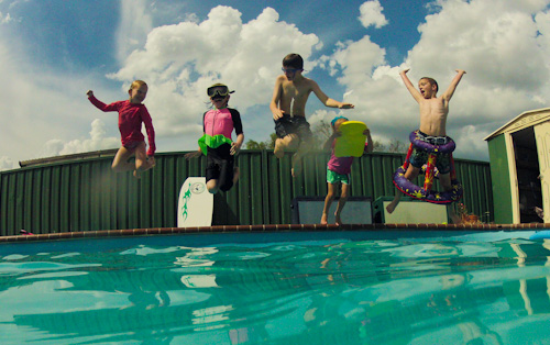 Fisher and Croaker cousins jumping into the pool, November 2012